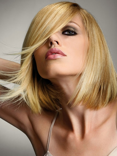 smooth and sleek golden blonde bob hairstyle by Royston Blythe